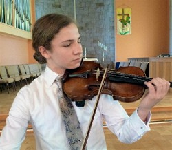 Violinst Danilo Thurber, co-winner of LRSO's student concerto competition, performs with the Lakes Region Symphony Orchestra on March 24, 2018 at Inter-lakes Auditorium in Meredith.