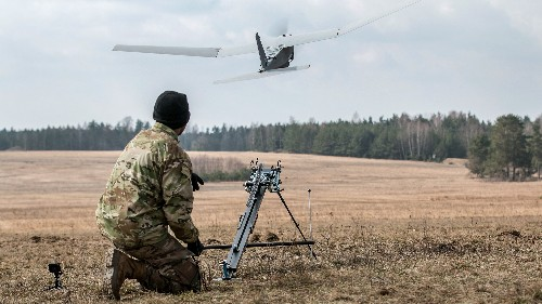 Army Pvt. Jonathan Jackson, a cannon crew member assigned to the 82nd Brigade Engineer Battalion, launches a Puma aviation system during a multinational joint equipment training brief in Grafenwoehr, Germany, April 2, 2018.