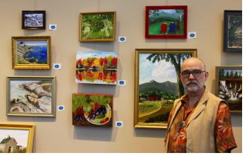 Dr. Stephen A. Kull displays some of his paintings at Androscoggin Valley Hospital in Berlin, NH