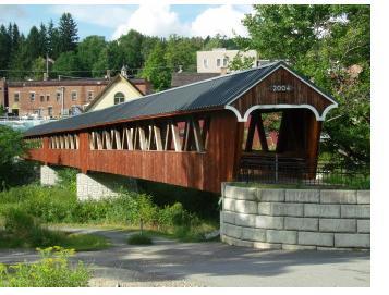 Built in 2004, the Riverwalk Covered Bridge has beautiful views of the river.