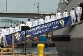The USS Manchester crew mans the rails.