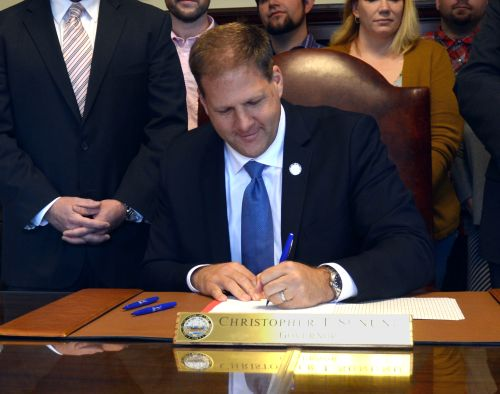 Governor Chris Sununu signs SB 234, relative to needle exchanges.