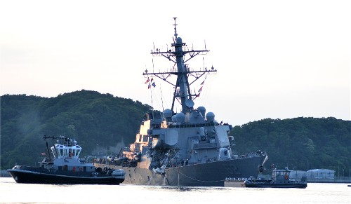 USS Fitzgerald (DDG 62), aided by tug boats, returned to Yokosuka at 6:15 p.m. this evening.